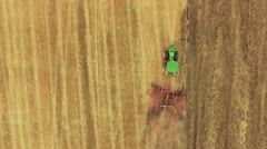 Tractor Ploughing Field Aerial Drone Footage Agriculture Cultivation Farming - stock footage