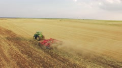 Aerial Tractor Ploughing Field Footage Agriculture Dirt Equipment Cultivation - stock footage