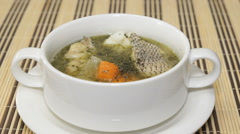 Fish soup from the Macrourus fish is stirred using a spoon in a tureen Stock Footage
