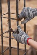 construction worker hands working with pincers on fixin - stock photo