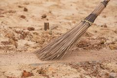 Coconut broom stick surrounded by dust Stock Photos