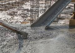 Concrete pouring during commercial concreting floors of buildings - stock photo