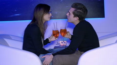 Young couple taking a cocktail in a club, snuggling Stock Footage