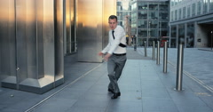 Contemporary funky caucasian businessman street dancer dancing freestyle in the Stock Footage