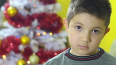 sad child for a wrong present in christmas time, frustrastion - stock footage