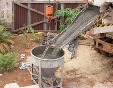 mixed concrete pouring - stock photo