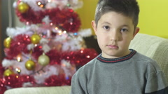 Young boy in christmas time, portrait of disillusion Stock Footage