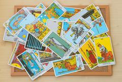 Mix of tarot card on the cork board Stock Photos