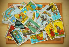 Mix of tarot card on the cork board in vintage style Stock Photos