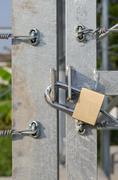 Locked brass keys. - stock photo