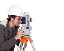 engineer working with survey equipment theodolite - stock photo