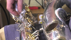 repairer of brass and wood wind instruments - stock footage