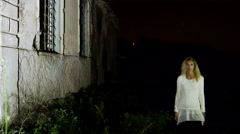 blonde woman alone in the dark night, walking like a mannequine and step and sto - stock footage