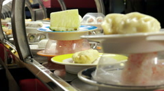 traditional japanese food in a fashion restaurant conveyed on a moving belt - stock footage