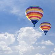 Hot air balloons on Blue sky background with white cloud. Kuvituskuvat