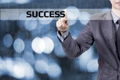Business man touch modern interface for SUCCESS concept on blue background. Stock Photos