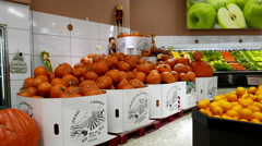 Motion of giant pumpkins for sale inside save on foods store Stock Footage