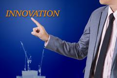 Businessman touch innovation word on business concept. - stock photo