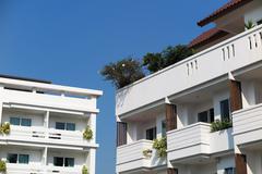 Modern hotel building element against a blue sky Stock Photos