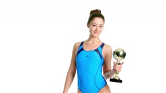 Young beautiful swimmer  holding a gold cup Stock Footage