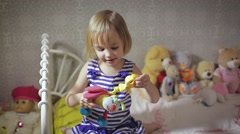 Cute kid girl playing with toy at home Stock Footage