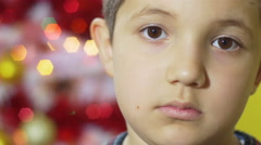 Depressed boy in christmas time, portrait Stock Footage