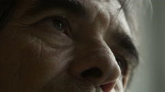 Intense glance of an adult man, detail on eyes and nose Stock Footage
