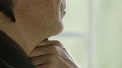 Profile view of an adult man,chin leaned on the hand, detail Stock Footage