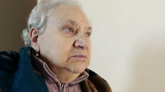 Old woman in a retirement home, mouth closed, eyes opened Stock Footage