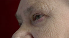 Old woman with wrinkled and corrugated face, detail, eye opened Stock Footage