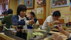 Asian Japanese People Eating Food In Traditional Restaurant Tokyo Japan - stock footage