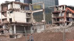 4K Ancient building demolition central city construction site excavator destroy  Stock Footage