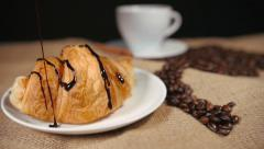 Pouring a Chocolate on Croissant Stock Footage