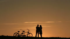 Silhouette of  Romantic Couple With Tandem Bicycle - stock footage