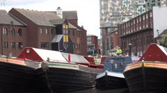 4K Guard man lookout barge anchor water canal Birmingham old town boat travel UK Stock Footage