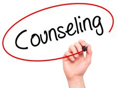 Man Hand writing Counseling with black marker on visual screen - stock photo