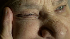 Stock Video Footage of expressive glance of an old wrinkled faced woman, eyes opened