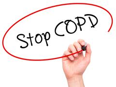 Man Hand writing Stop COPD with black marker on visual screen - stock photo