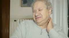 Retired woman grey haired lamenting a cervical problem Stock Footage
