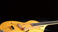 Frets, string, body, mouth and bridge of typical classic spanish guitar gyrating Stock Footage