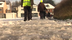 People walking in the snow Stock Footage
