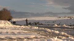 Man walking  in snowy landscape. Stock Footage