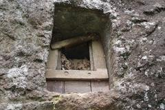 Traditional cave grave carved in the rock.  Lemo is cliffs old burial site in - stock photo