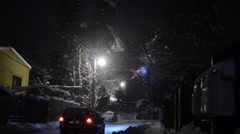 Auto traffic in a city covered with snow Stock Footage
