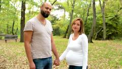 handsome man and young pregnant woman disagree together to camera  - stock footage