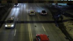Car traffic in city at night unfolded Stock Footage