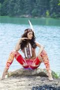Young woman in costume of American Indian, outdoor - stock photo