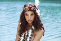 Young woman in costume of American Indian, outdoor Stock Photos