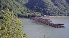 View of a water storage dam. On both sides of the water, you can see  Stock Footage