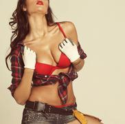 Beautiful young brunette in a plaid shirt Stock Photos